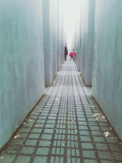 Kids playing at Holocaust Memorial Berlin Urban Urban Geometry