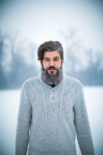 Portrait of bearded young man during winter