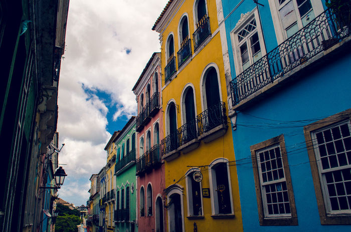 A street in Salvador da Bahia Window Building Exterior Architecture Cloud - Sky Sky Outdoors No People Low Angle View Day Travel Destinations Built Structure City Salvador Da  Bahia Brasil Brazil South America Houses Pelourinho Pelourinhosalvador Brasil ♥ Brazil ❤ Been There. This Is Latin America The Architect - 2018 EyeEm Awards The Architect - 2018 EyeEm Awards The Traveler - 2018 EyeEm Awards