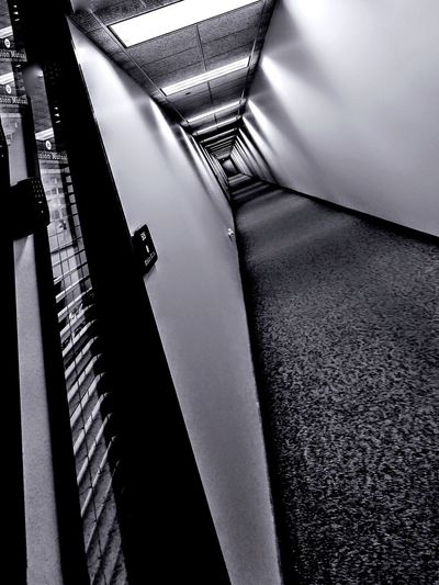 oppressive interiors Interior Views Black And White Blackandwhite Photography Shapes And Forms Shadowplay Corridor Long Corridors Backgrounds Pattern Full Frame