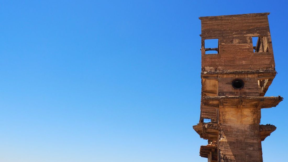 Ancient Civilization Architecture Blue Building Exterior Built Structure Clear Sky Clock Day History Low Angle View No People Outdoors Place Of Worship Religion Sky Tower Travel Destinations Wood - Material