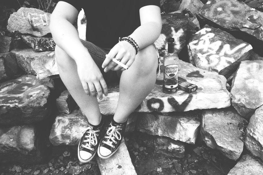 Hey boy. The Portraitist - 2016 EyeEm Awards The Essence Of Summer Hooligans Smoking Cigarettes Booze Southern Comfort Graffiti Graffiti Art Suburban Edgy Converse Converse All Star