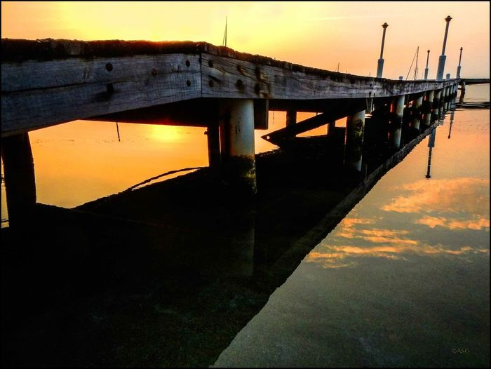 Dock @ Dawn Bridge - Man Made Structure Built Structure Connection Leading Long Ocean Outdoors Pier Silhouette Sunrise In Placencia, Belize - 1/15 Water Waterfront