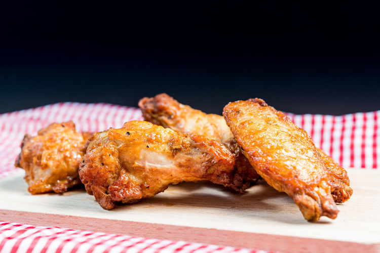Close-up of fried chicken on cutting board