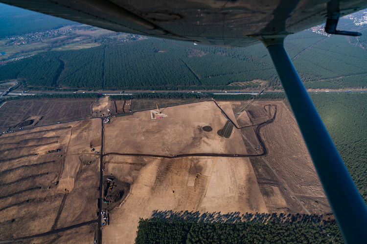 High angle view of agricultural landscape seen through airplane