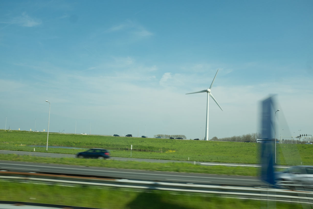 wind turbine, wind power, alternative energy, environmental conservation, renewable energy, fuel and power generation, windmill, industrial windmill, sky, day, transportation, field, outdoors, no people, nature, technology, rural scene, grass