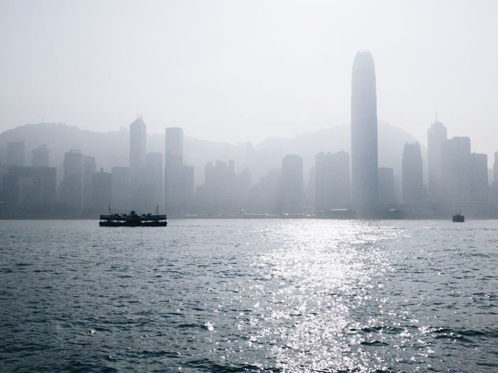 Foggy City Clean Star Ferry Victoria Harbour Water City Architecture Nautical Vessel Waterfront Building Exterior Built Structure Transportation Sea Sky Skyscraper Fog Nature Travel No People Cityscape