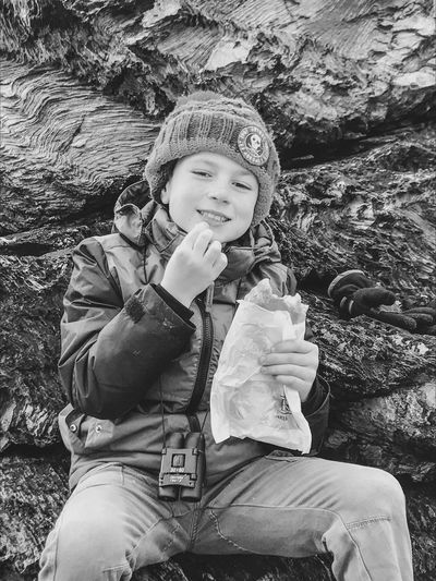 Hi Eating On The Go Eating Lunch Childhood Real People Sitting Smiling One Person Portrait Outdoors Happiness Looking At Camera Elementary Age Nature Sat On The Cliff Eating Out Daily Exploring Free Activities Family Time Boy With Binoculars Sat On The Cliff Bottom Eating A Cornish Pasty Black And White Black And White Friday