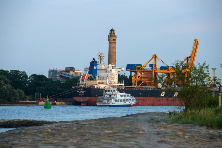 Baltic Sea Lighthouse Architecture Building Exterior Built Structure Clear Sky Cruise Ship Day Industry Mode Of Transportation Nature Nautical Vessel No People Outdoors Passenger Craft Sea Ship Sky Tower Transportation Travel Water Waterfront