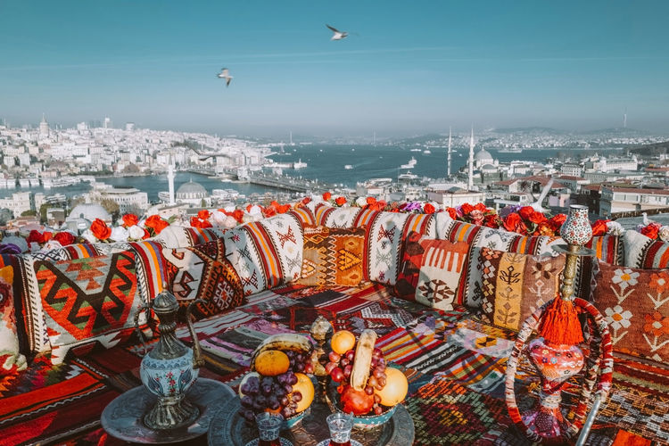 Rooftop view with traditional carpet and turkish tea. top view of the city of istanbul