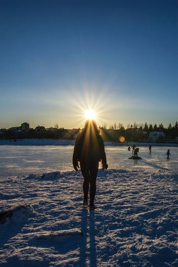 Reykjavik Tjörnin Iceland_collection Iceland Cold Temperature Winter Snow Sunlight Sun Nature Sunset Sunbeam Scenics Beauty In Nature Outdoors Sky Landscape Day No People Ice Skate Silhouette