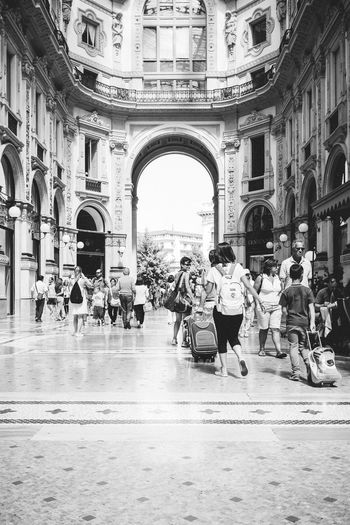 People Enjoying At Galleria Vittorio Emanuele Ii