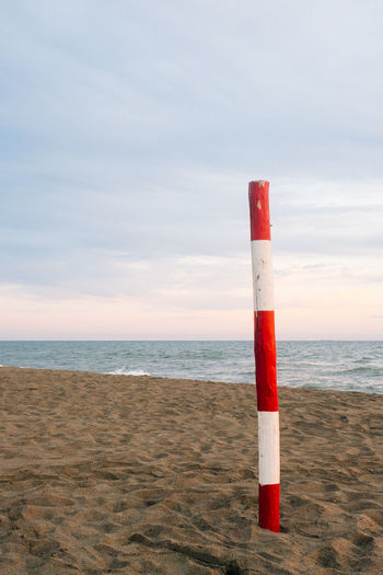 Pole Beach Beauty In Nature Cloud Cloud - Sky Cloudy Day Fujifilm_xseries Horizon Over Water Idyllic Nature No People Outdoors Red Remote Scenics Sea Shore Sky Tranquil Scene Tranquility Vscofilm Water Weather