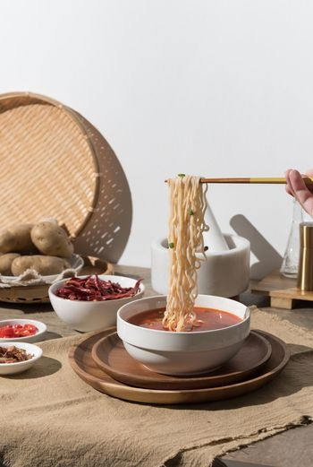 Noodles lunch Food And Drink Food Indoors  Table Still Life Plate No People Wellbeing Sweet Food Chopsticks Wall - Building Feature Copy Space Bowl Healthy Eating Wood - Material Freshness Studio Shot Home Interior Day Ready-to-eat
