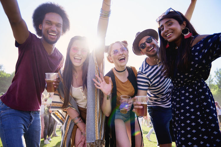Portrait of young adult friends having fun at festival Friends Beer Drink Festival Outdoors Music Festival Traditional Festival Alcohol Hold Party Music Summer Crowd Fun Entertainment Celebration Boho Meeting Multi Ethnic Group Asian  Indian African African American People Festival Goer Sunglasses Fashion Fashionable Freedom Carefree Group Of People Happiness Joy Live Event Adult Young Adult Playful Popular Music Concert Positive Emotion Smiling Traveling Carnival Youth Culture Women Men Look At Camera Lean