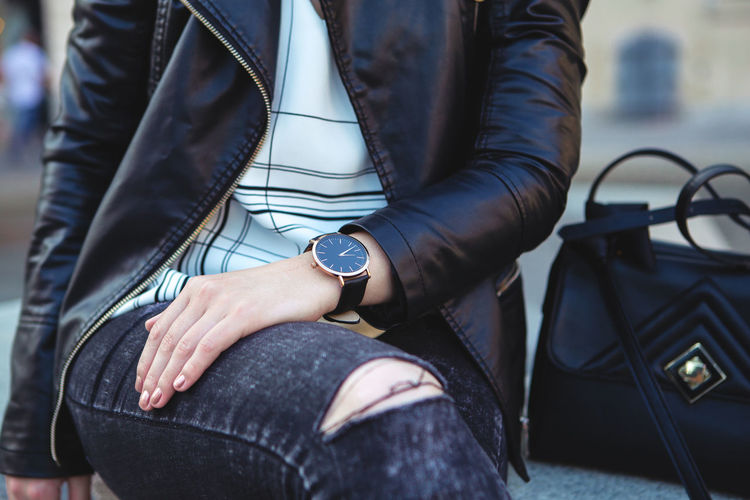 Close up portrait of Young woman city lifestyle with Watch on her wrist Midsection One Person Real People Focus On Foreground Hand Sitting Casual Clothing Holding Wristwatch Human Hand Watch Leather Time Human Body Part Clothing Men Day Lifestyles Adult Outdoors Jeans Human Limb Fashion Blogger Urban Urbanphotography City Ljubljana Slovenia Portrait Portrait Of A Woman Woman Young Adult Young Women Casual Look
