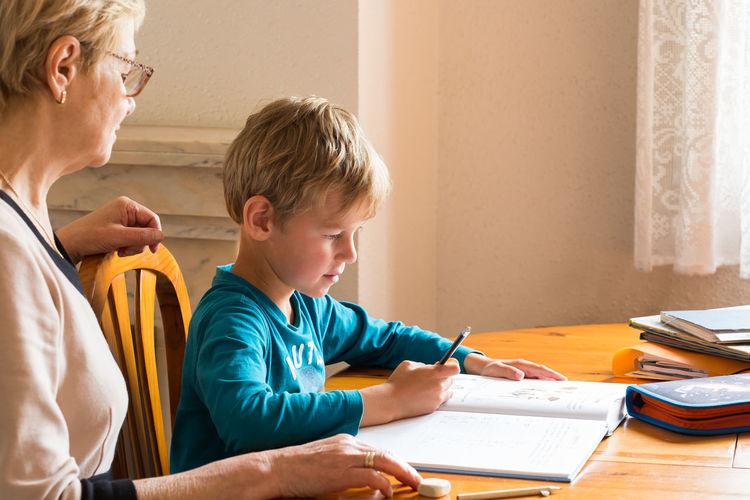 Boy and book on table