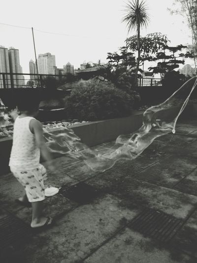 Building Exterior Outdoors City Built Structure Day Architecture One Person Full Length Women Tree People Sky One Woman Only Adults Only Adult Cityscape Philippines Kids Bubbles Blackandwhite Monochrome Play Fun Outdoor Giantbubble