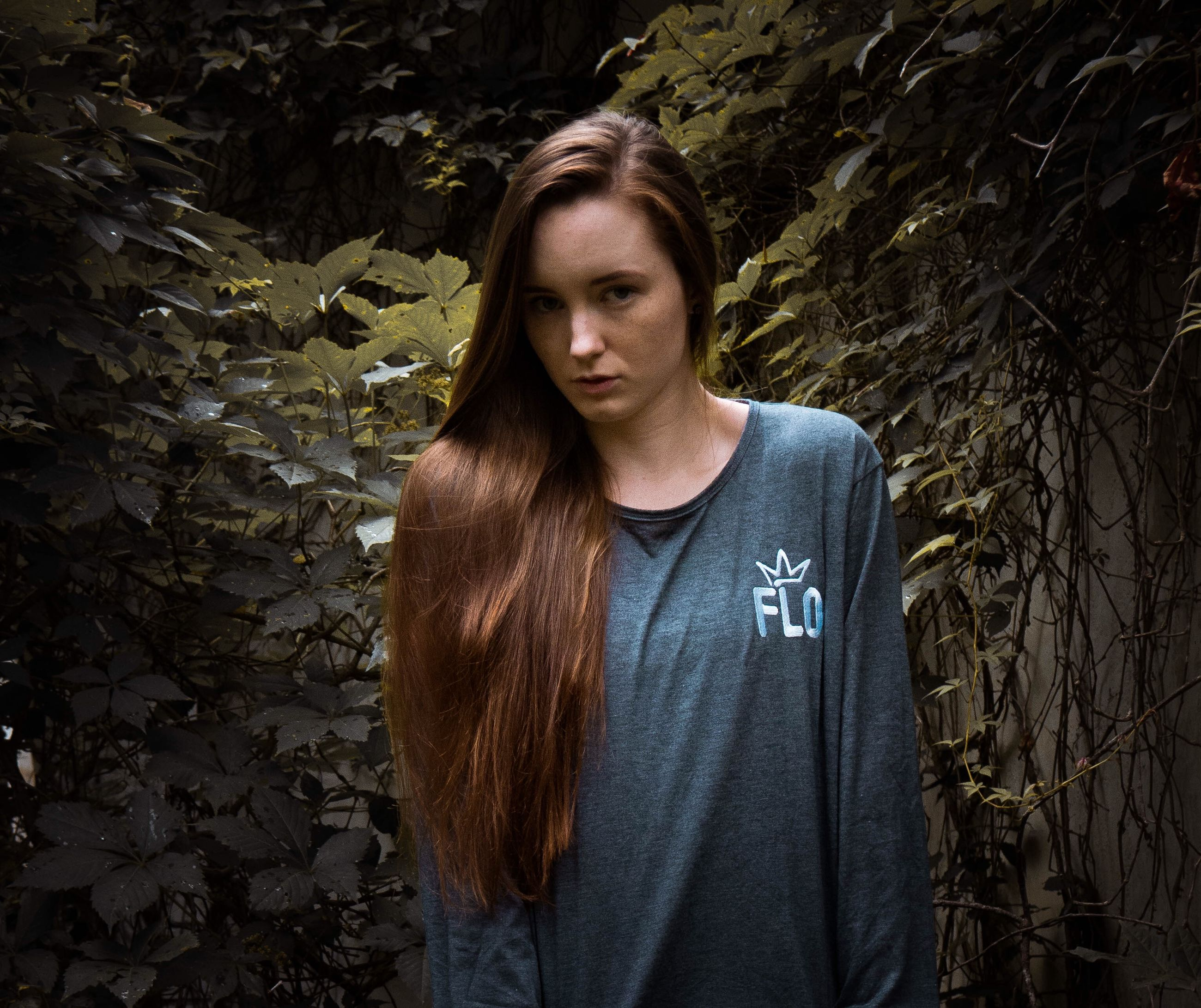 portrait, young adult, looking at camera, one person, front view, tree, standing, plant, leaf, plant part, casual clothing, young women, real people, beauty, forest, hairstyle, day, long hair, lifestyles, outdoors, beautiful woman, teenager, change, leaves
