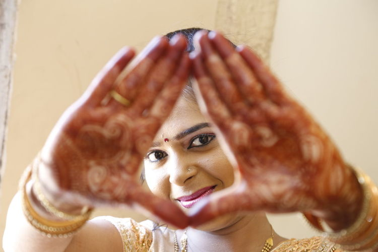 Close-Up Of Young Woman's Hands In Henna Tatoos