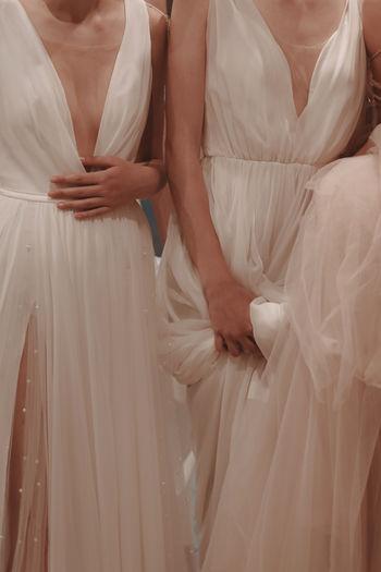 Details of wedding dresses. cropped models. white long dress, fashion vertical shot