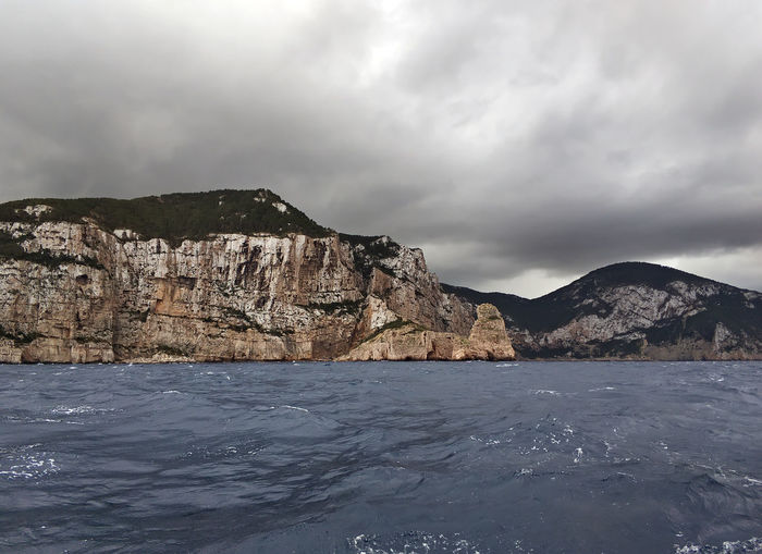 North rocky coast of Ibiza at stormy weather. Balearic island, Spain Dramatic Sky Ibiza Ibiza Island Ibiza, Spain Mediterranean Sea Moody Sky Rocky Coastline SPAIN Weather Balearic Islands Beauty In Nature Cliff Cloud - Sky Europe Mountain Nature No People Nobody Rocky Coast Scenics - Nature Sea Sky Tourism Travel Destinations Water