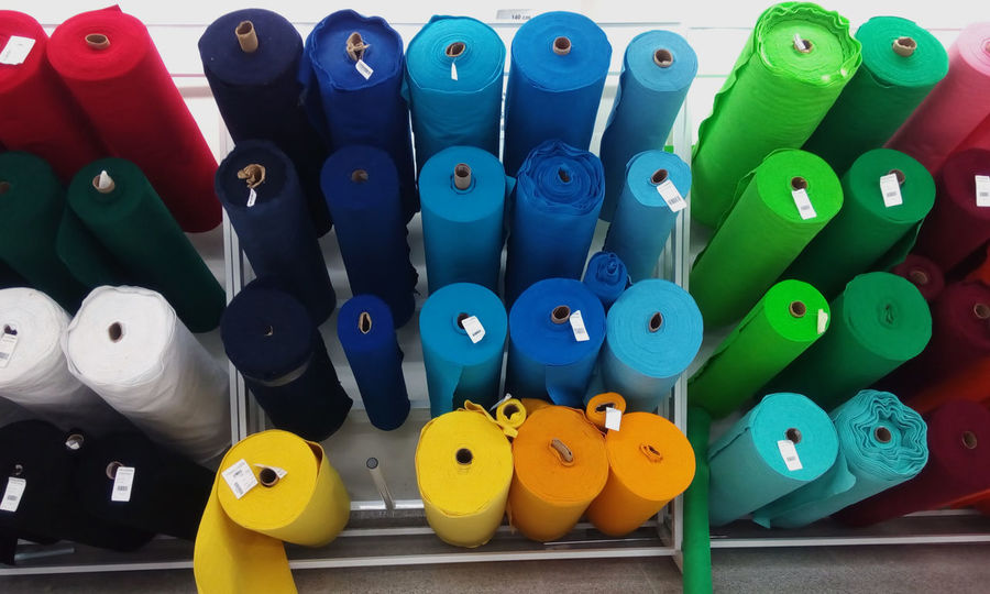 View of felt rolls of various colors for sale in a store. Felt Multi Colored Large Group Of Objects Choice Variation Representation Still Life No People Close-up Animal Representation Indoors  Plastic Art And Craft Toy Arrangement Yellow Blue Creativity Thread Order Group Of Objects