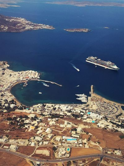 Harbour Of Mykons Mykonos,Greece Aerial View Architecture Bay Beach Building Building Exterior Built Structure City Cityscape Day Flying High Angle View Land Mode Of Transportation Nature Nautical Vessel No People Outdoors Scenics - Nature Sea Transportation Water