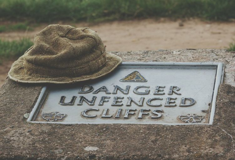 Communication Text Western Script Close-up Focus On Foreground Man Made Object Green Color Hat Danger Sign