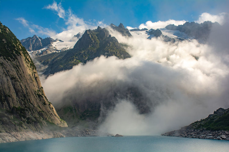 Mountains around the gelmer lake on a cloudy day.