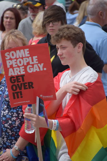 Signs shown during UK Pride parade as part of Hull UK City of Culture 2017 (22nd July 2017) Hull Hull City Of Culture 2017 Pride In Hull Protest Signs Communication Crowd Day Fan - Enthusiast Hull 2017 Leisure Activity Lgbt Lgbt Pride Lifestyles Men Outdoors People Pride Parade Real People Red Text Togetherness