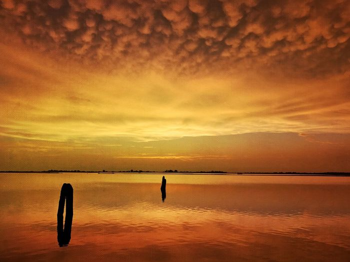 Something with Mammatus Clouds Sunset Scenics Orange Color Beauty In Nature Water Nature Tranquil Scene Tranquility Sky Sea No People Silhouette Horizon Over Water Outdoors Day EyeEm Nature Lover Streamzoofamily EyeEmSwiss Mammatus Clouds And Sky Reflection