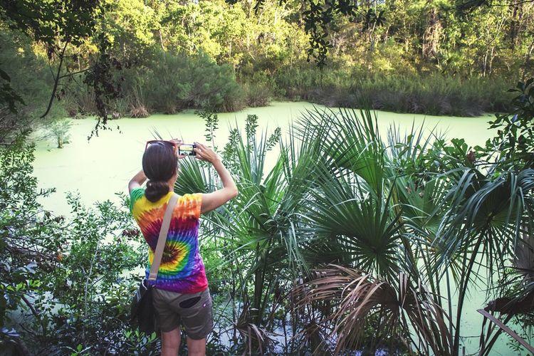 Girl standing on riverbank