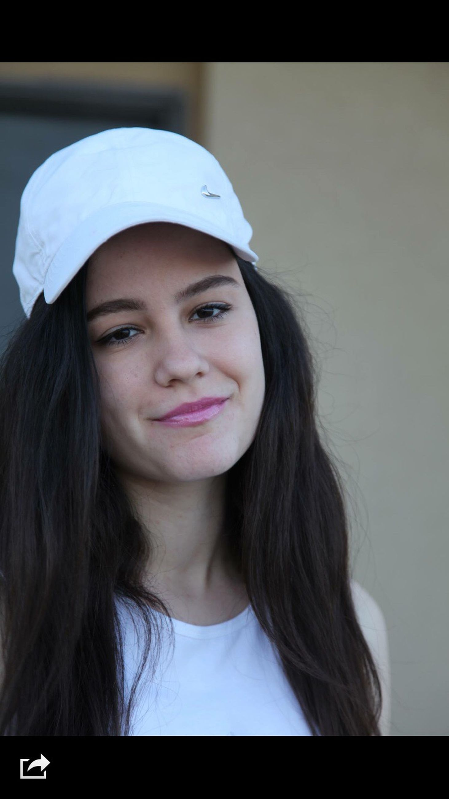 young women, young adult, long hair, person, headshot, indoors, portrait, looking at camera, lifestyles, front view, head and shoulders, leisure activity, brown hair, smiling, black hair, contemplation