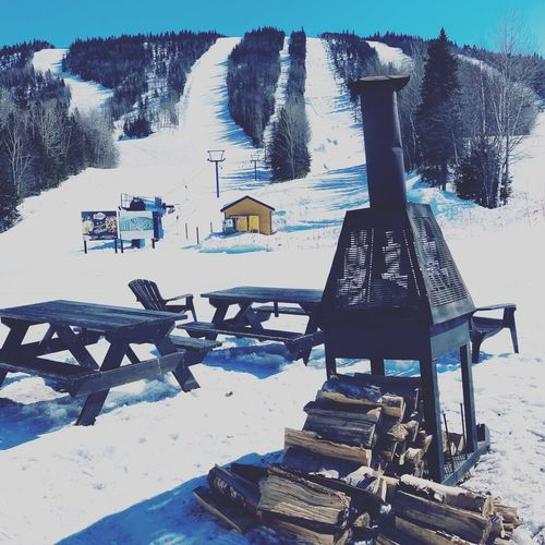 Ski Holiday Ski Slope Sky And Clouds Ski Day Nature No People Outdoors Seat Architecture Text Graffiti Wall - Building Feature Snow Built Structure Sunlight Winter Art And Craft Creativity Communication Bench Cold Temperature Western Script