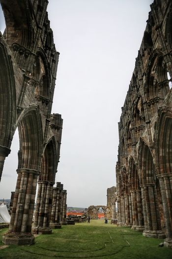 Whitby Whitby Whitby Abbey Architecture Built Structure Sky The Past History Travel Destinations Travel Building Exterior Tourism Nature Ancient Day Arch Clear Sky City Old Building No People Low Angle View Outdoors Architectural Column Ancient Civilization Archaeology Abbey