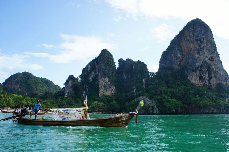 Boat outside Ao Nang, Krabi Travel Photography Travel Destinations Boat Ao Nang, Krabi. AoNang Ao Nang Ao Nang, Krabi. Thailand Thailand Tropical Paradise Newstrekker Gettylicious Mountain View Landscape_Collection Tourism Green Sea