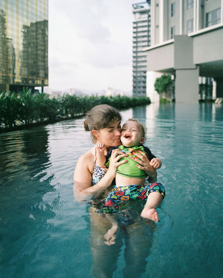Mother and son in swimming pool