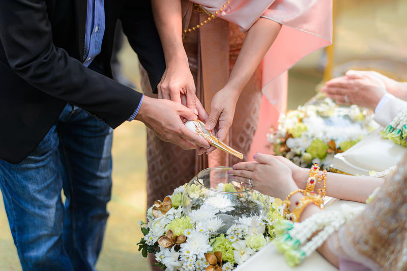 Parents pouring water on bride hands