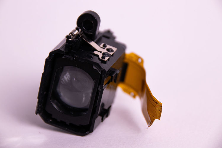 Close-up of camera against white background