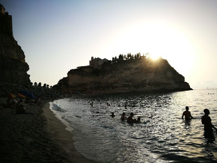 Silhouette Water Nature Outdoors People Beauty In Nature Sky Day Tropea Sea EyeEm Selects Summer Vacations Travel Destinations Travel Blue Sun Sunset Beach