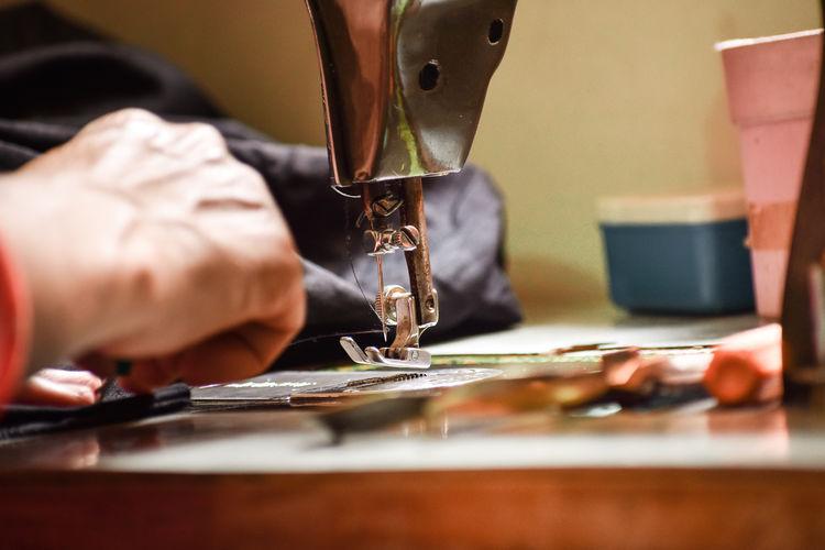 Man working in sewing manhine