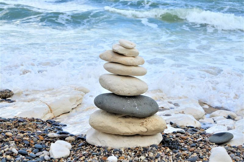 Stack Stone - Object Balance Rock Solid Pebble Stone Water Beach Rock - Object Nature Land Sea Zen-like No People Day Beauty In Nature Tranquility Outdoors Stack Rock