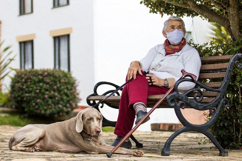 Man with dog sitting on street