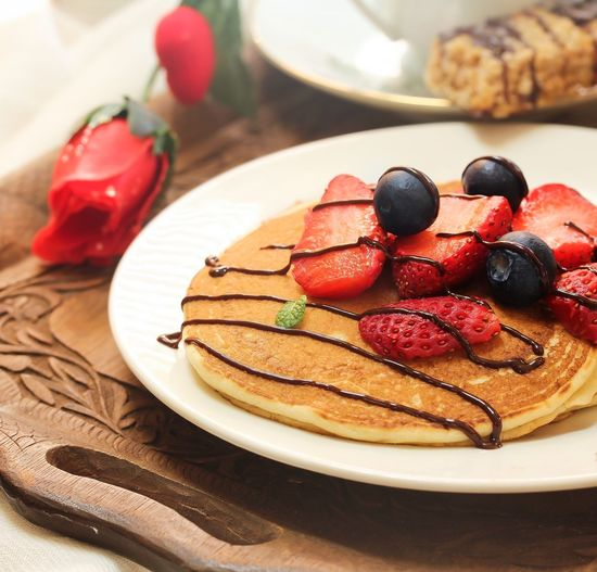 Close-up of pancake on plate on table