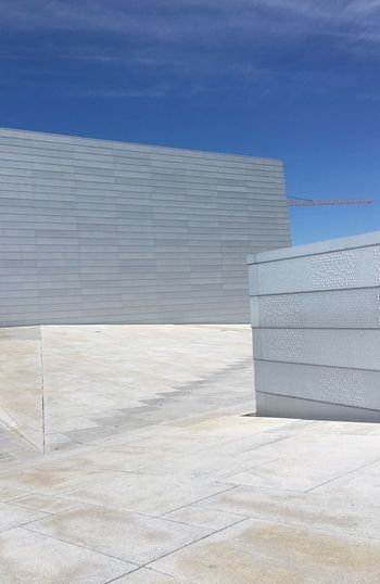 White building against blue sky on sunny day