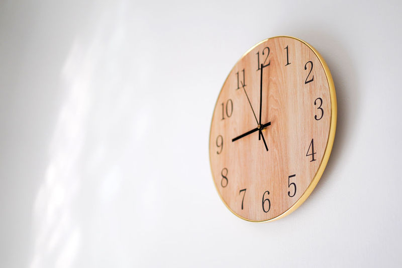 9 o'clock, good morning Number Time Clock Wall - Building Feature Indoors  No People Single Object Circle Shape Wall Clock Copy Space Clock Face Clock Hand Cut Out Wood - Material Instrument Of Time Hour Hand Light And Shadow Hanging Out Good Morning 9 Oclock 9am