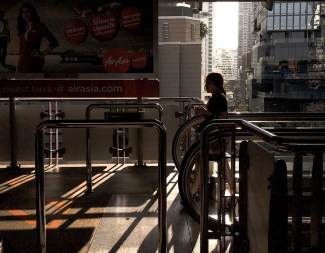 Bangkok Thailand Urban Sunrise Sunset Real People Architecture One Person City Built Structure Transportation Rear View Lifestyles Men Indoors  Sunlight Railing City Life Mode Of Transportation Travel Shadow