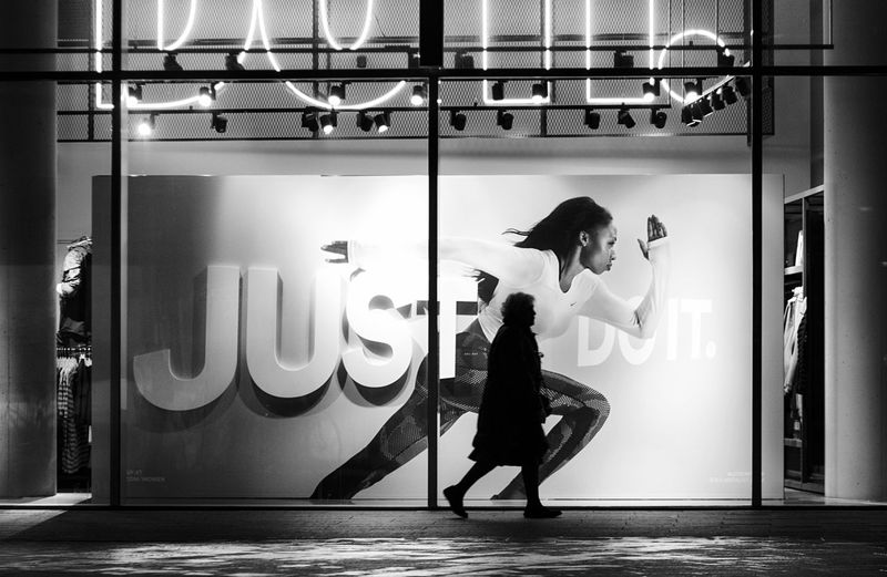 Just Do It... Black & White Blackandwhite Streetphotography Street Photography Streetphoto_bw Blackandwhite Photography EyeEm Best Shots Eye4photography  Juxtaposition Indoors  Men Glass - Material Transparent Full Length Illuminated Well-dressed Looking Monochrome Photography