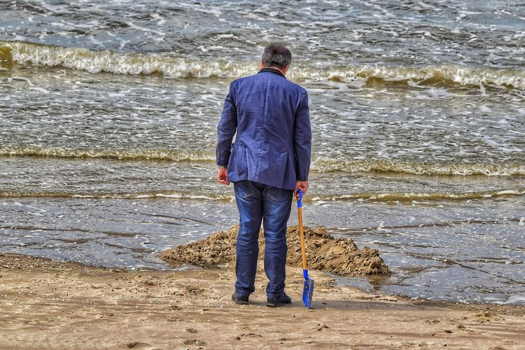 Building A Castle Water Wave Sea Full Length Beach Standing Men Sand Ankle Deep In Water Rear View Calm The Portraitist - 2018 EyeEm Awards The Street Photographer - 2018 EyeEm Awards The Fashion Photographer - 2018 EyeEm Awards